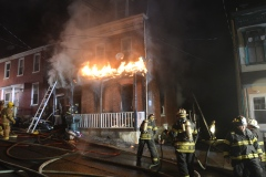 NICK MEYER/STAFF PHOTO Firefighters battle a blaze at 622 N. Second St., Pottsville, around 2 a.m. Wednesday.