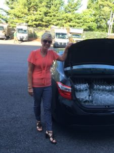 Cadet Troop L Board Member Jackie Hoffman Wenrich Delivers Our Water Donation to Campers